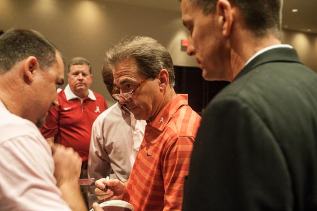 Coach Saban spent some time signing autographs for fans