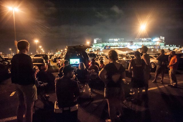 Those who couldn't afford the $900-$1750 ticket watched from the stadium parking lot