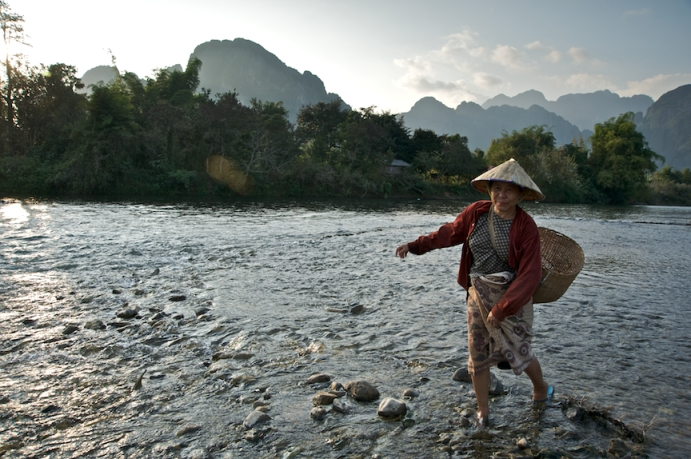 Woman crossing the Nam Song