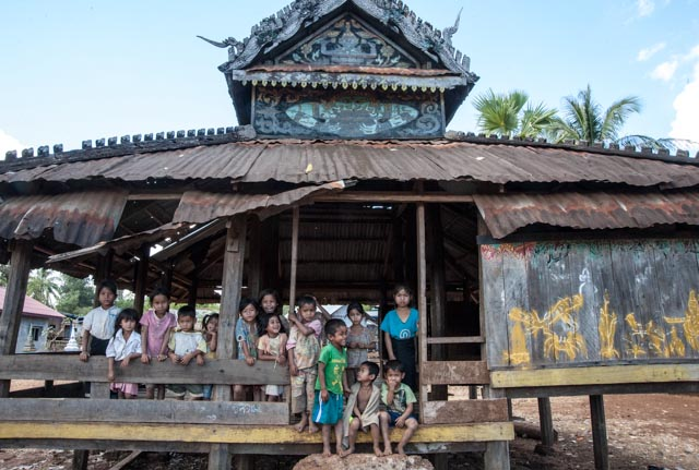 Kids hanging out at the village temple