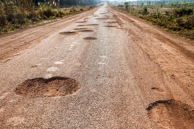 Roads still pockmarked due to bombing during the Vietnam War