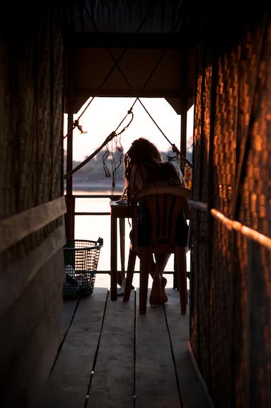 A tourist enjoys the quietness of a bungalow