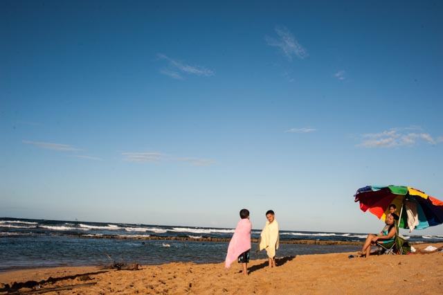 A family enjoys the seaside near San Juan