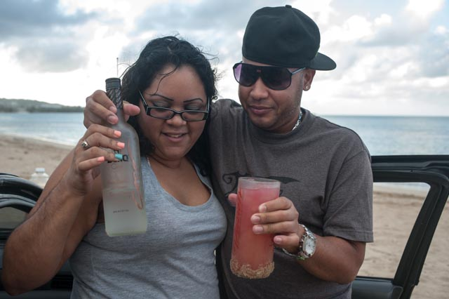 A Puerto Rican couple pauses for a portrait as they relax along the beach near Luquillo