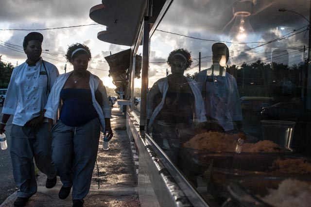 A couple heads home from working at a food vendor strip mall near Luquillo, Puerto Rico