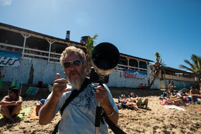 A surf photographer taking in the action...